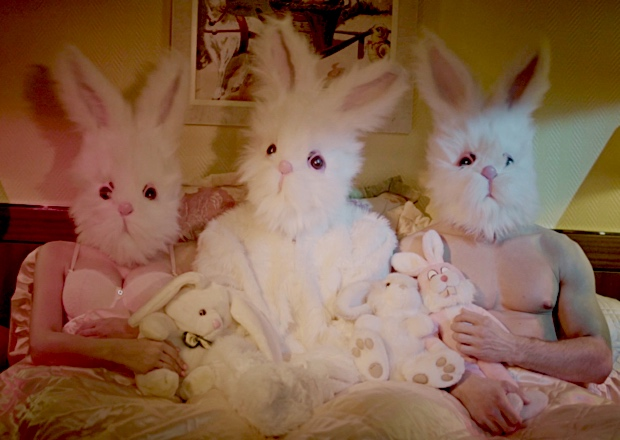easter bunnies sitting in bed